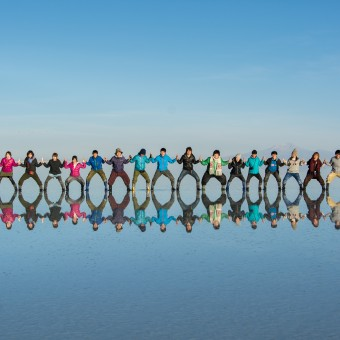 PIC BY HIDEKI MIZUTA / CATERS NEWS - A man has been spotted walking on water in Bolivia, that is, until you realise it is an optical illusion. Hideki Mizuta, 29, from Japan, captured the image of the wellie-clad tourist strolling across the water and towards the sun, while he was at Salar de Uyuni salt flat in Bolivia. As one of the flattest places in the world, Salar de Uyuni becomes covered in a thin layer of water during the rainy season and becomes a mirror image of the sky at that moment in time.